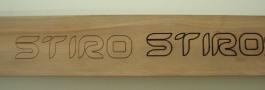Laserschneiden von Schriftzug in Holzteppich